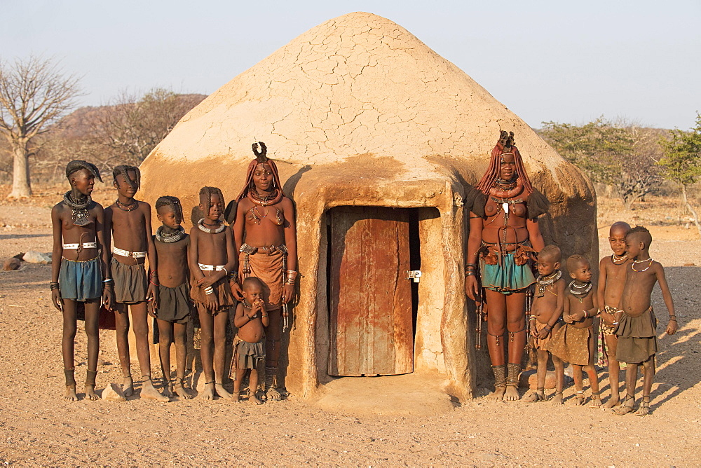 Himba women with children in front of a sleeping hut, Kaokoveld, Namibia, Africa