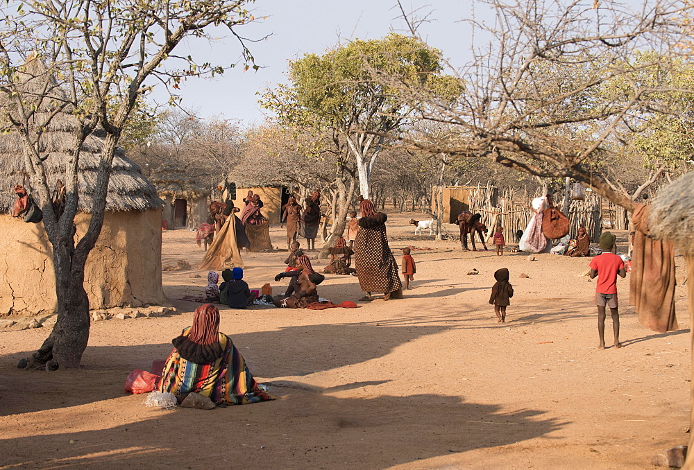 Himba women and children in a Himbadorf, Kaokoveld, Namibia, Africa