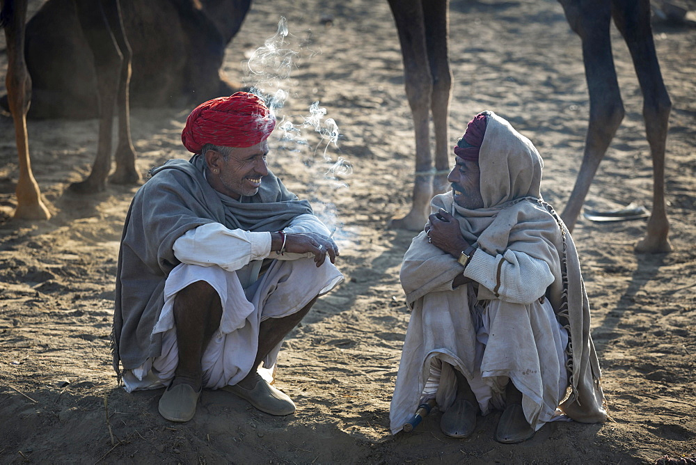 Two men having a break, Pushkar Camel Fair, Pushkar, Rajasthan, India, Asia