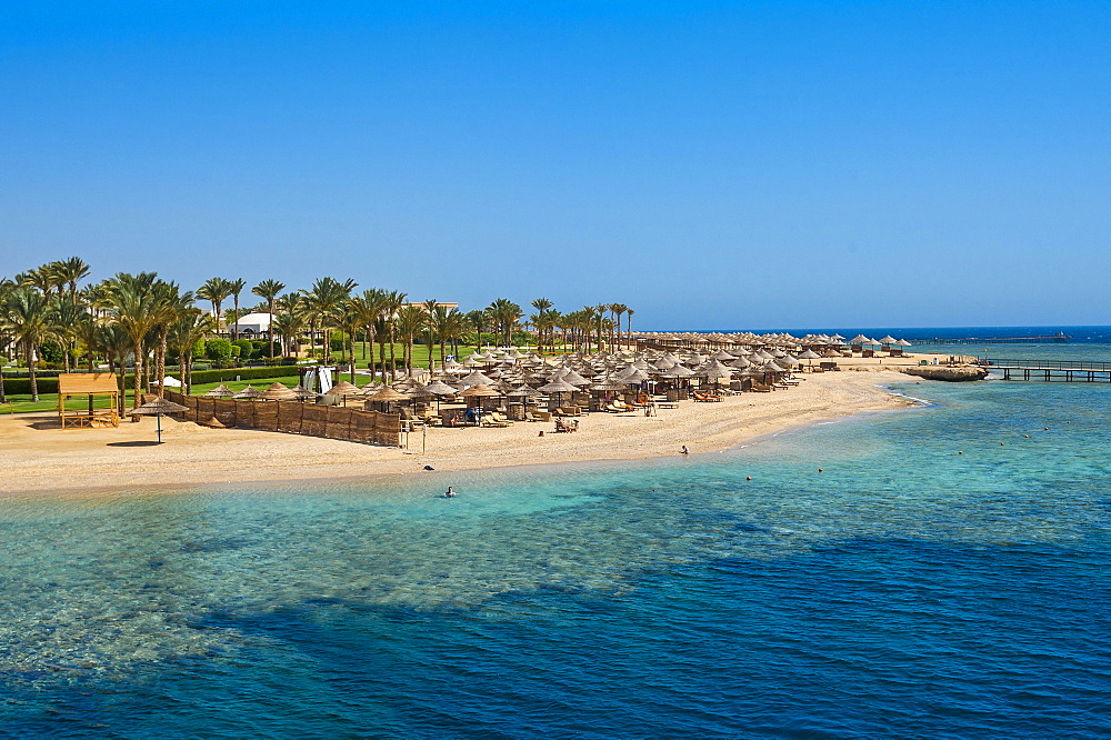 Beach with umbrellas, Port Ghalib, Marsa Alam, Red Sea, Egypt, Africa