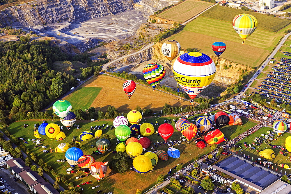 Different colored hot air balloons rising into the air, hot air balloon festival, 26th international Warsteiner Montgolfiade, Warstein, Sauerland, North Rhine-Westphalia, Germany, Europe