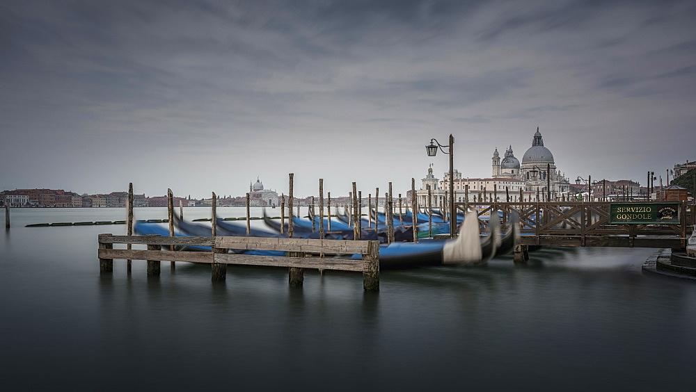 Gondolas in the Canale di San Marco, in the back church Santa Maria della Salute, lagoon of Venice, Venetia, Italy, Europe