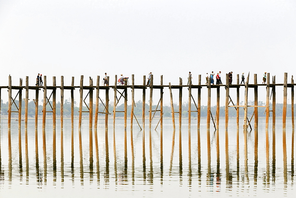 People crossing U Bein bridge, Taungthaman Lake, Mandalay region, Myanmar, Asia
