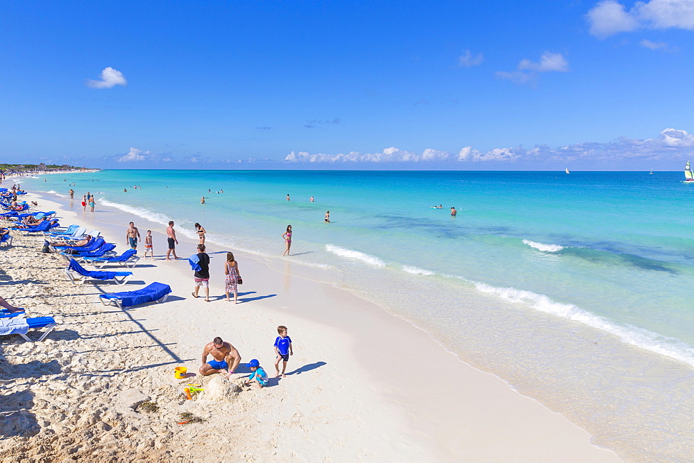 Tourists on the sandy beach with turquoise water, Hotel Melia Las Dunas, island of Cayo Santa Maria, Caribbean, Cuba, Central America