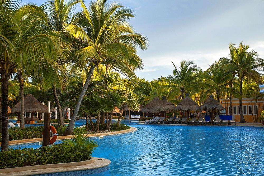 Palm trees, swimming pool, beach chairs, palm umbrellas, Iberostar Paraiso Beach resort, Playa del Carmen, Quintana Roo, Riviera Maya, Mexico, Central America