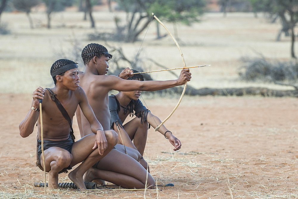Kung Bushmen with bow and arrow, Zebra Lodge, Hardap Region, Namibia, Africa