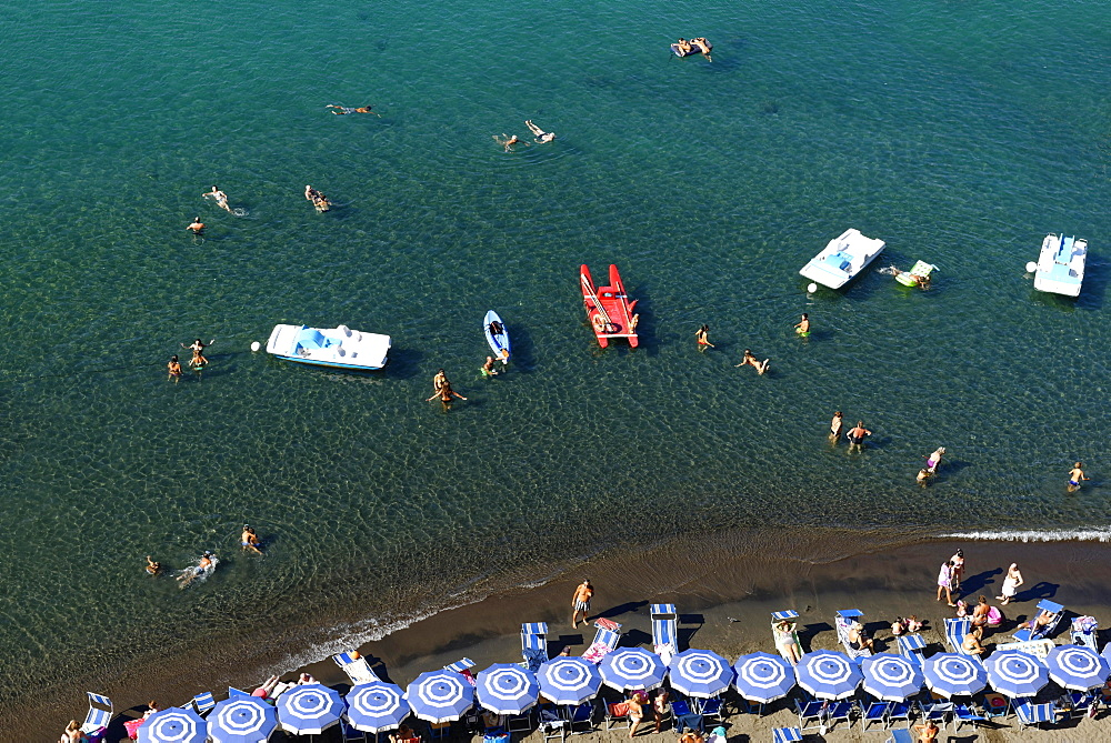 Tourists, bathers on the beach with sunshades, bird's eye view, Sorrento, Sorrentine Peninsula, Amalfi Coast, Campania, Italy, Europe