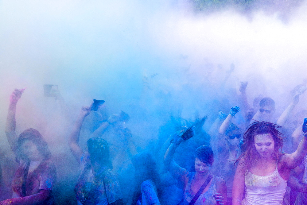 Thousands of young women and man are throwing color powder in the air at the colorful Holi festival, Dresden, Saxony, Germany, Europe - 832-379953