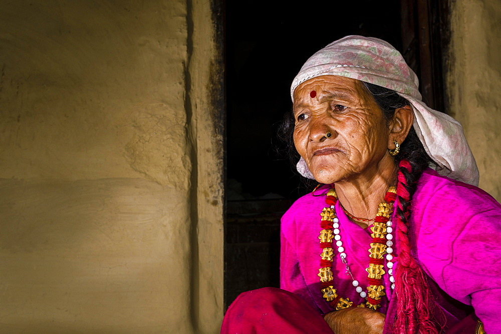 Portrait, old, wrinkled native woman, wearing pink shirt, Ghandruk, Kaski District, Nepal, Asia