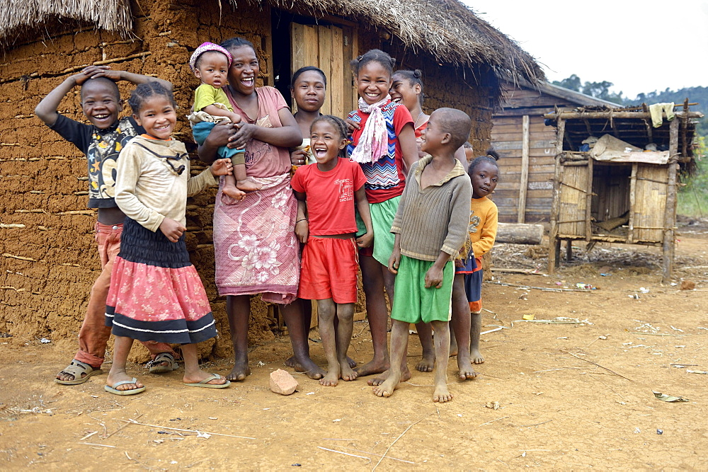 Laughing women and children in front of hut, Berano, Moramanga, Alaotra-Mangoro region, Madagascar, Africa