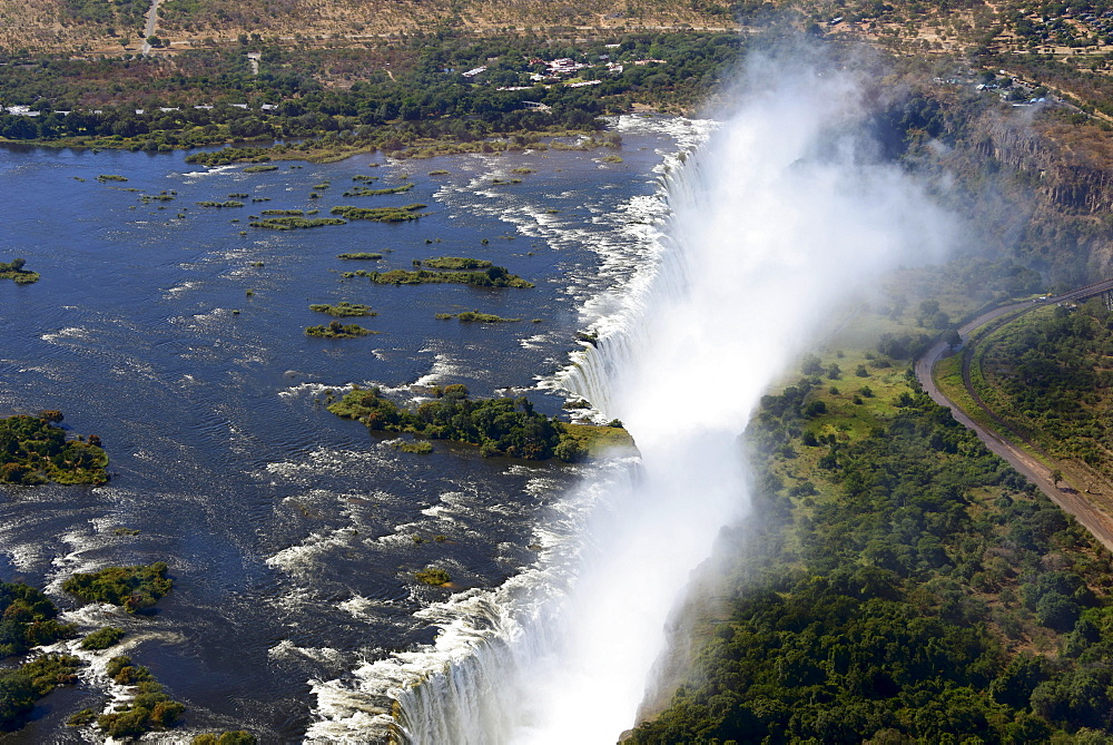 Aerial View, Zambezi river flows into the Victoria Falls, border of Zambia and Zimbabwe, Africa