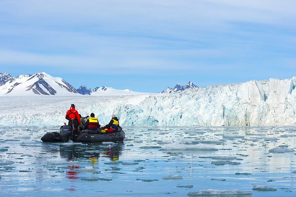 Zodiac boat with tourists navigating in front of Lilliehook glacier, Lilliehook fjord, Spitsbergen Island, Svalbard Archipelago, Norway, Europe