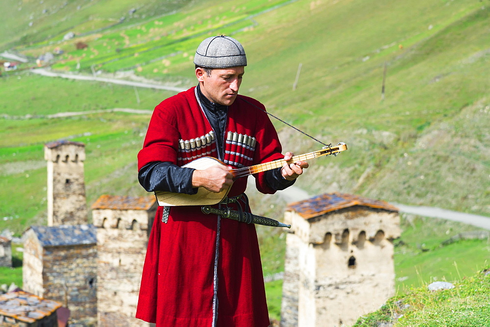 Georgian musician of a folkloric group playing Panduri, Ushguli, Svaneti region, Georgia, Asia