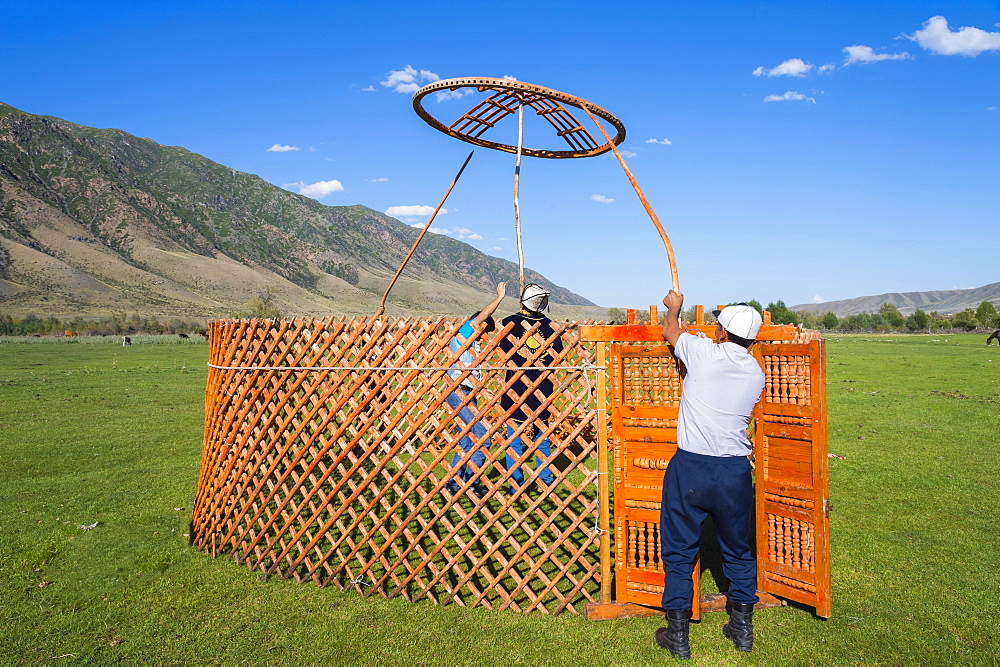 Kazakh men putting up a yurt, Sati village, Tien Shan Mountains, Kazakhstan, Asia