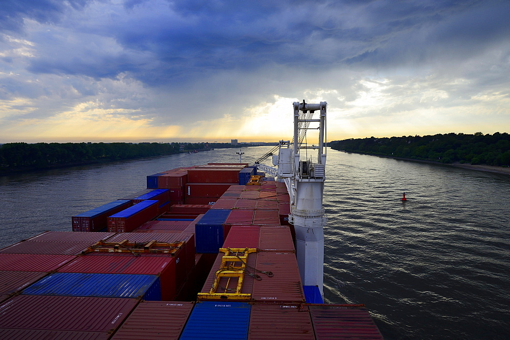 Cargo ship with containers, dusk, Elbe, Hamburg, Germany, Europe