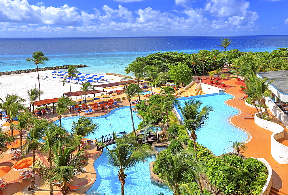 Beachfront swimming pool complex, Hilton Hotel, Bridgetown, Barbados, Lesser Antilles, Caribbean Sea, West Indies, Central America