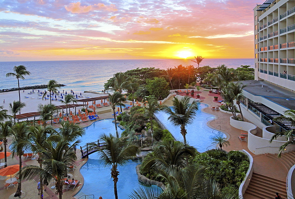 Swimming pool and beach of the Hilton Hotel at sunset, Brigdetown, Barbados, Caribbean, Lesser Antilles, West Indies, Central America