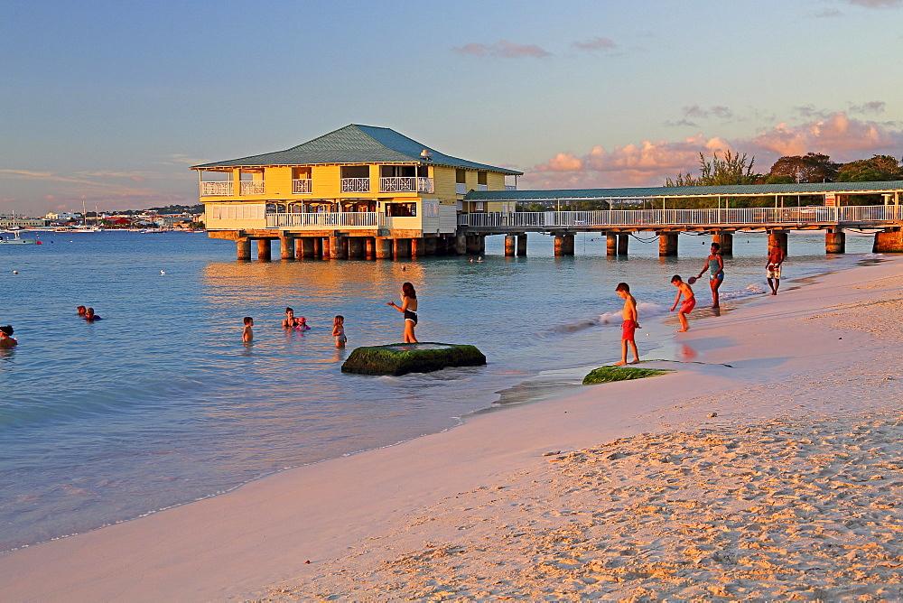 Pebbles Beach Palm beach at Carlisle Bay with sea bridge at evening sun, Bridgetown, Barbados, Lesser Antilles, West Indies, Caribbean Islands, Central America