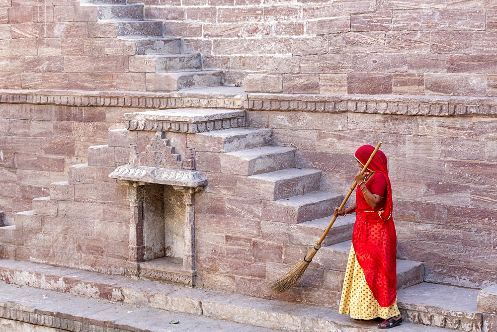 Woman in Sari cleaning the steps at Toorji Ka Jhalara, The Step Well, Jodhpur, Rajasthan, India, Asia - 832-380105