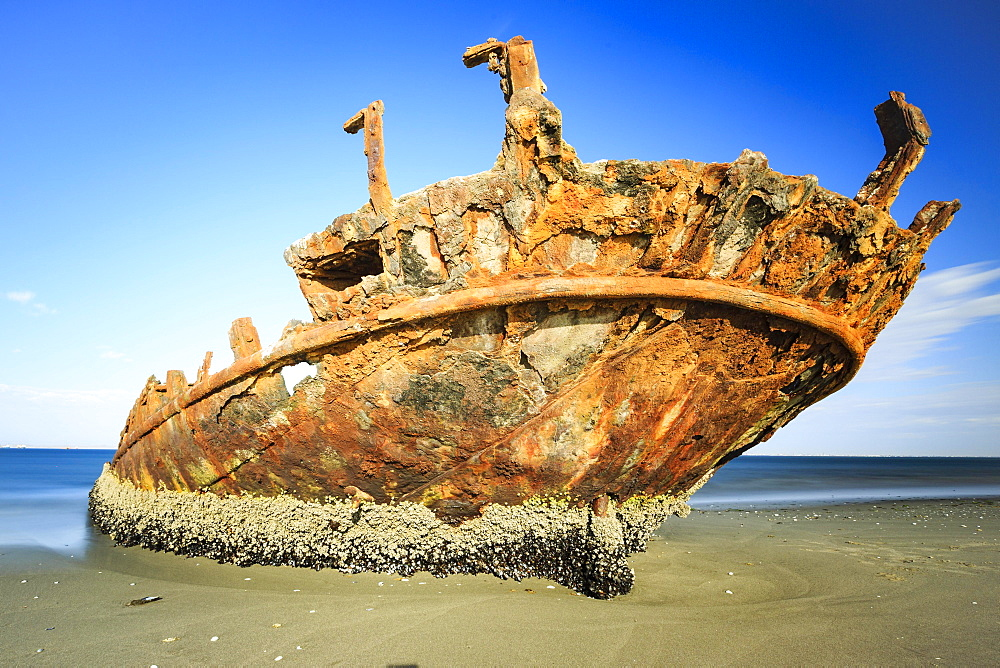 Rusty shipwreck on the beach, Pelican Point, Skeleton Coast, Erongo region, Namibia, Africa