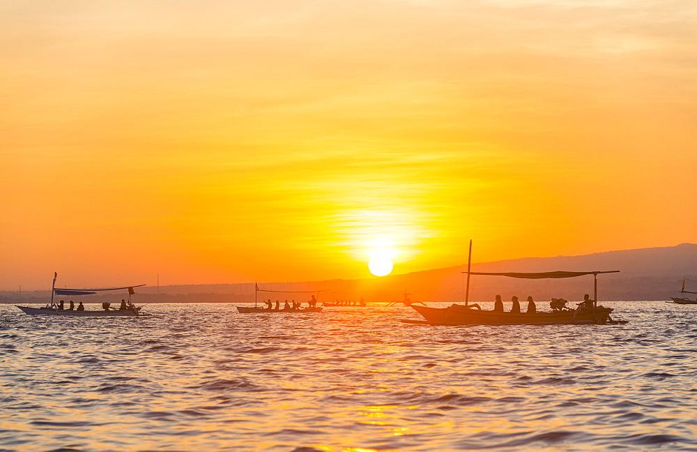 Sunrise, outrigger canoes in the sea, Lovina Beach, Bali, Indonesia, Asia