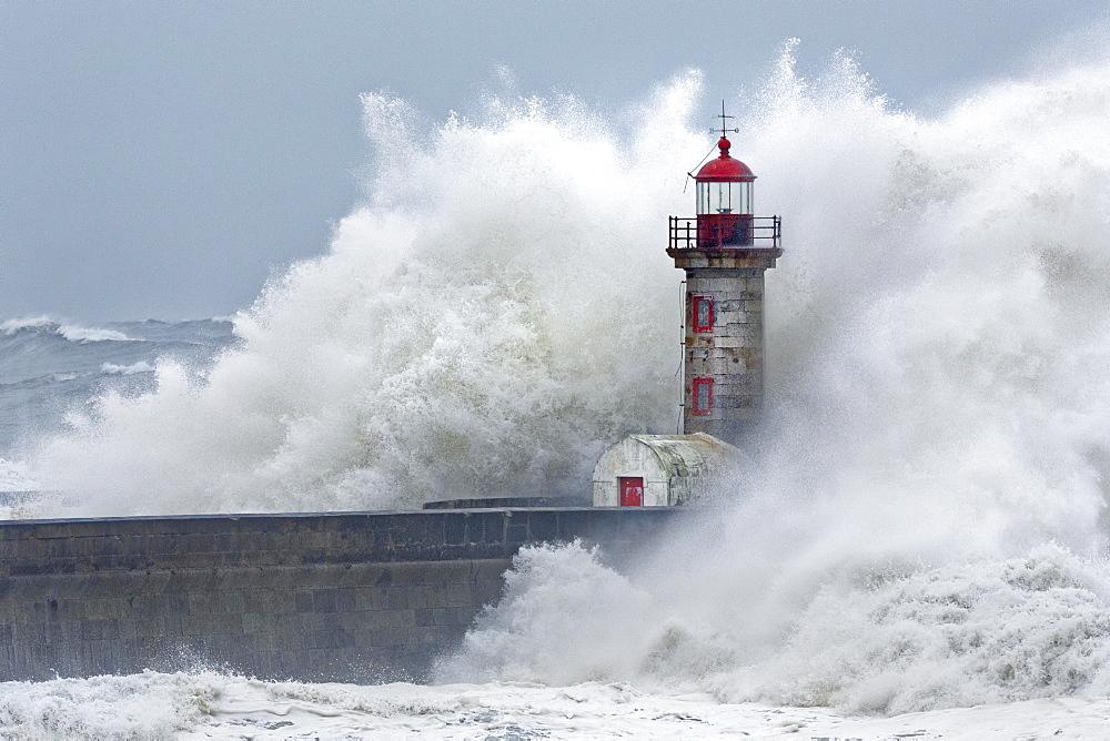 High waves, splashing spray, lighthouse during storm, Porto, Portugal, Europe