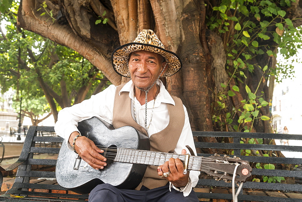 Street musician with guitar, Santo Domingo, Dominican Republic, Central America