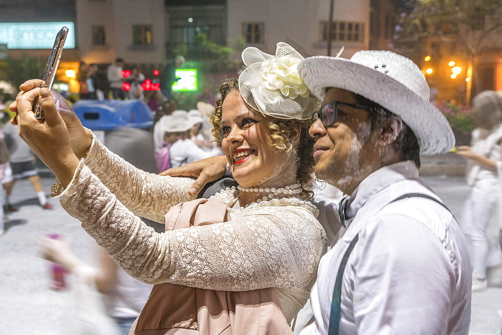 Dressed up couple, white powder and white clothes, carnival La fiesta de Los Indianos, Las Palmas de Gran Canaria, Canary Islands, Spain, Europe
