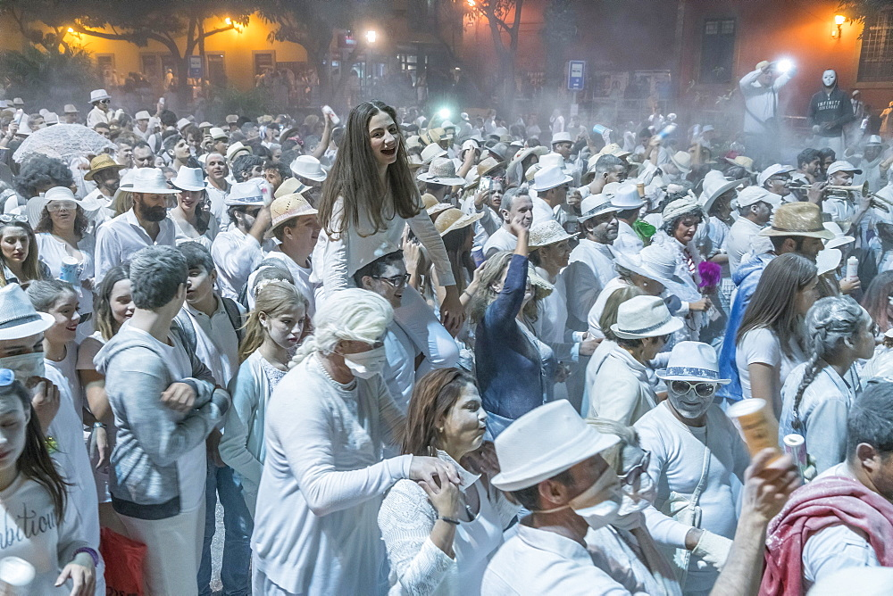Crowd of people, white powder and white clothes, evening mood, carnival La Fiesta de los Indianos, Las Palmas de Gran Canaria, Canary Islands, Spain, Europe