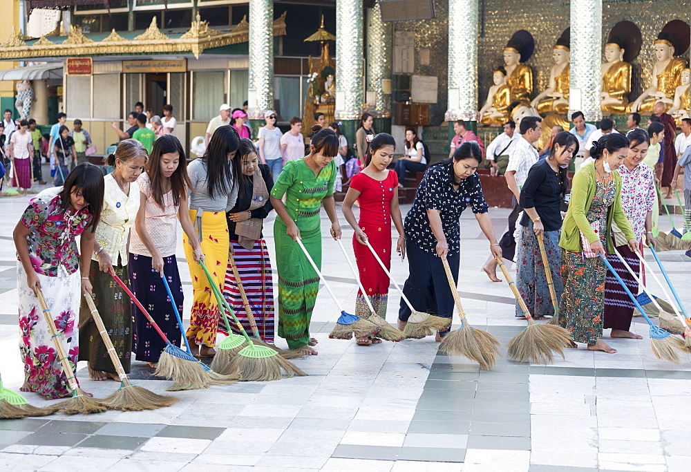 Burmese women sweeping the floor of the Shwedagon Pagoda, Yangon, Rangoon, Myanmar, Asia