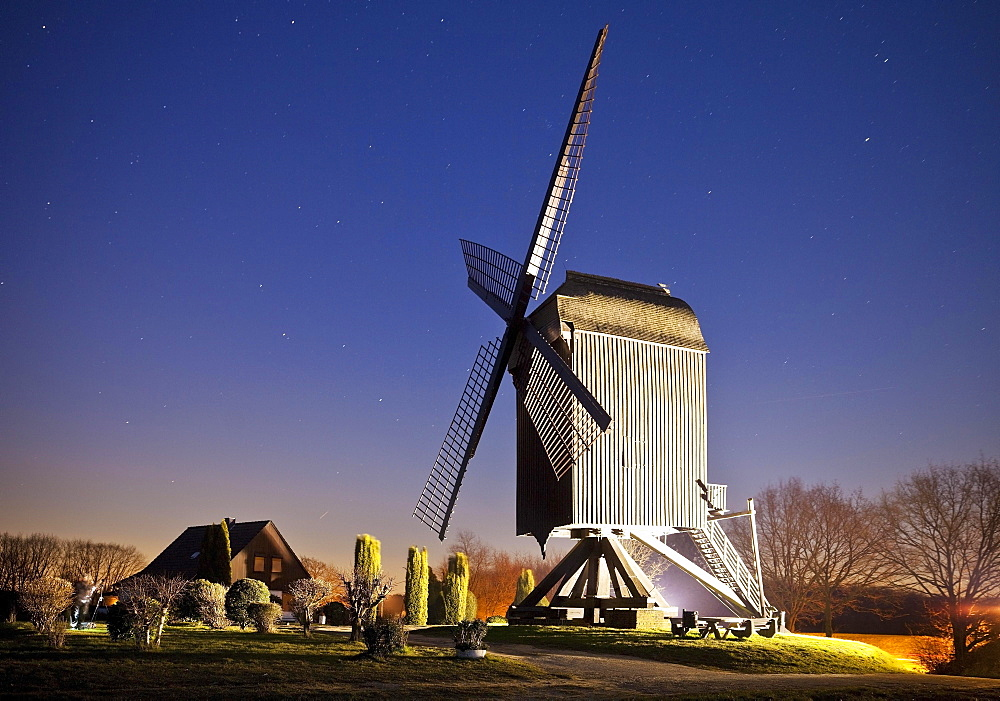 Illuminated Kastenbockwindmühle, historical windmill, with starry sky, Tönisberg, Kempen, Lower Rhine, North Rhine-Westphalia, Germany, Europe