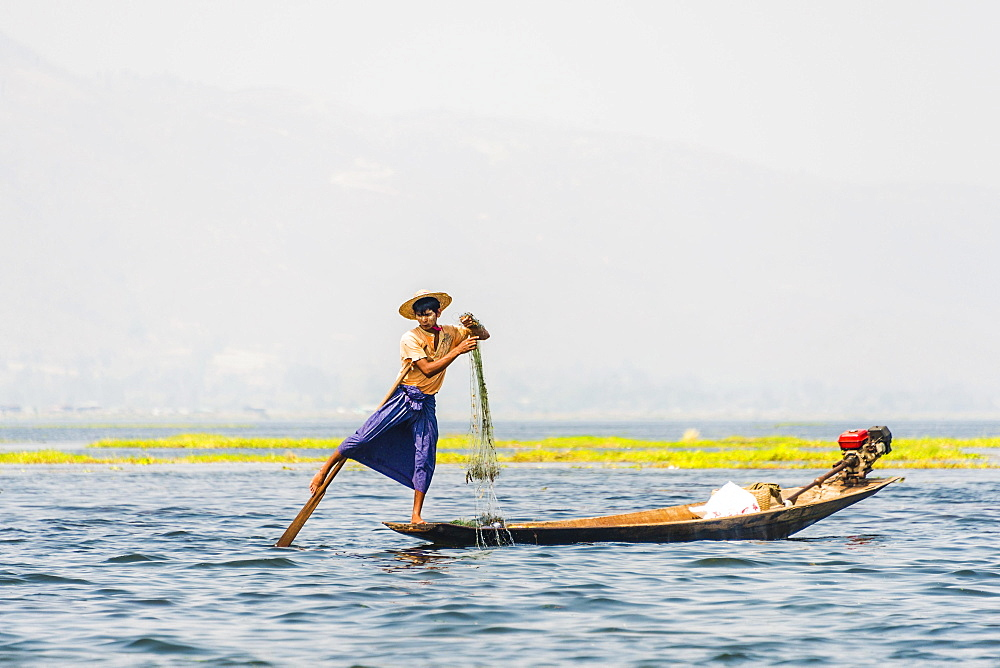 Local fishermen leg rowing on wooden boat, Inle Lake, Shan State, Myanmar, Asia
