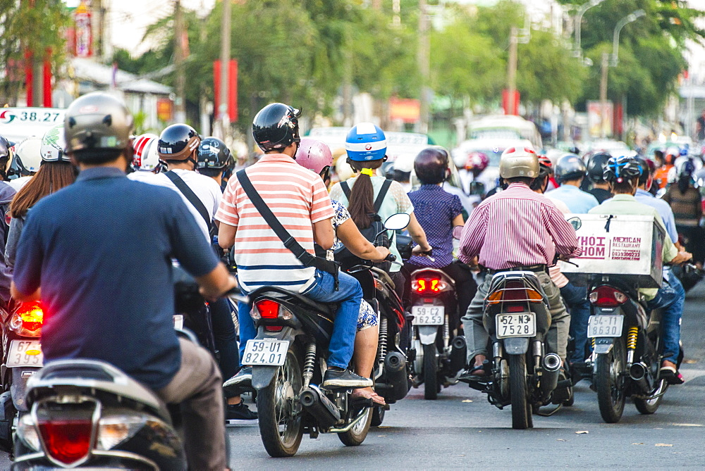 Crowd of scooter drivers in heavy traffic, Ho Chi Minh City, Vietnam, Asia