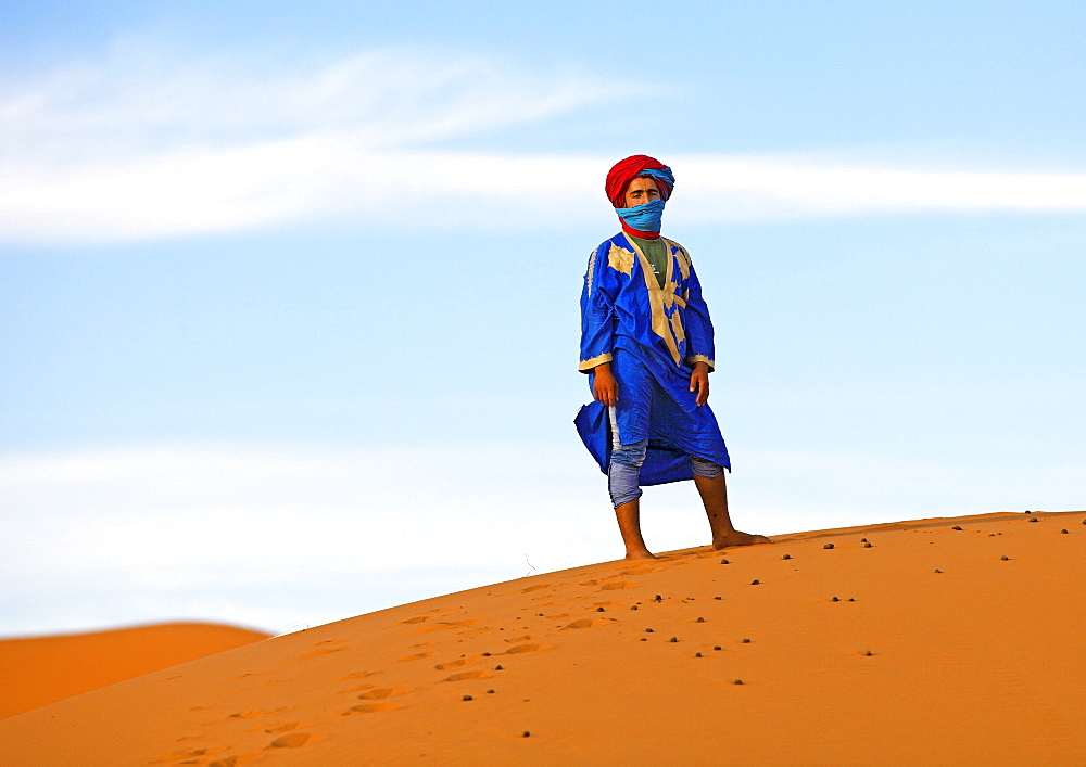 Bedouin on a dune, Erg Chebbi, Draa-Tafilalet province, Morocco, Africa
