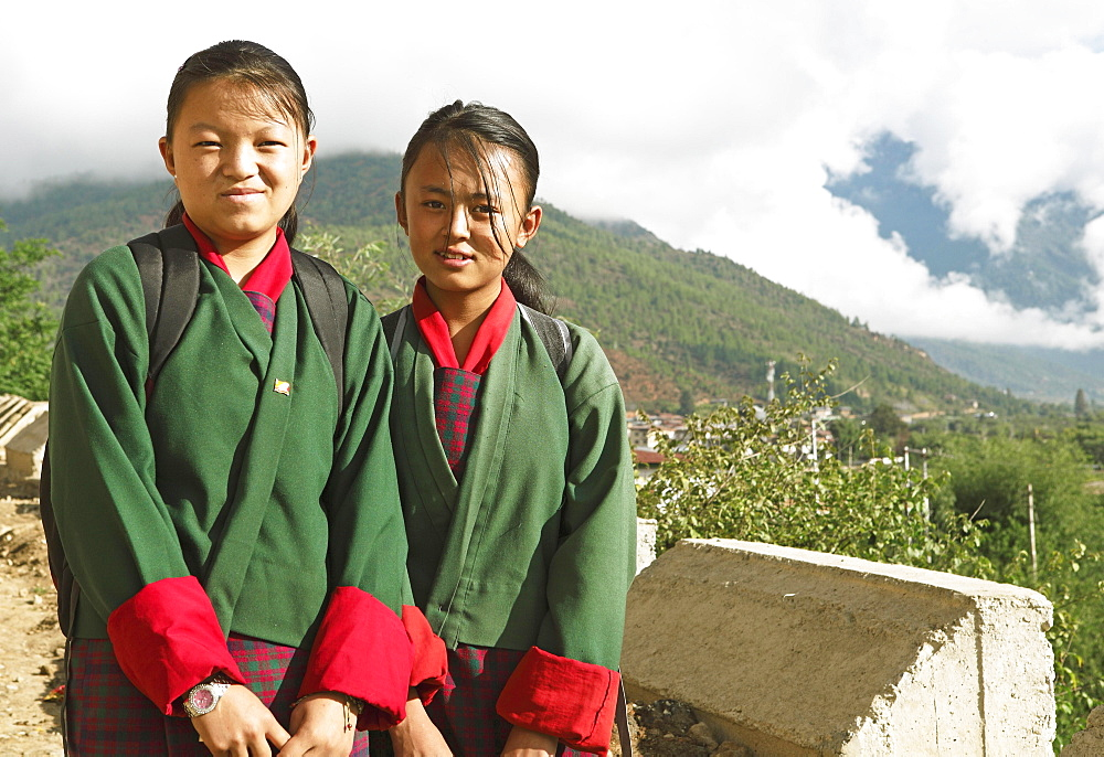 Girls wearing the traditional Kira dress in Paro, the Himalayas, Kingdom of Bhutan