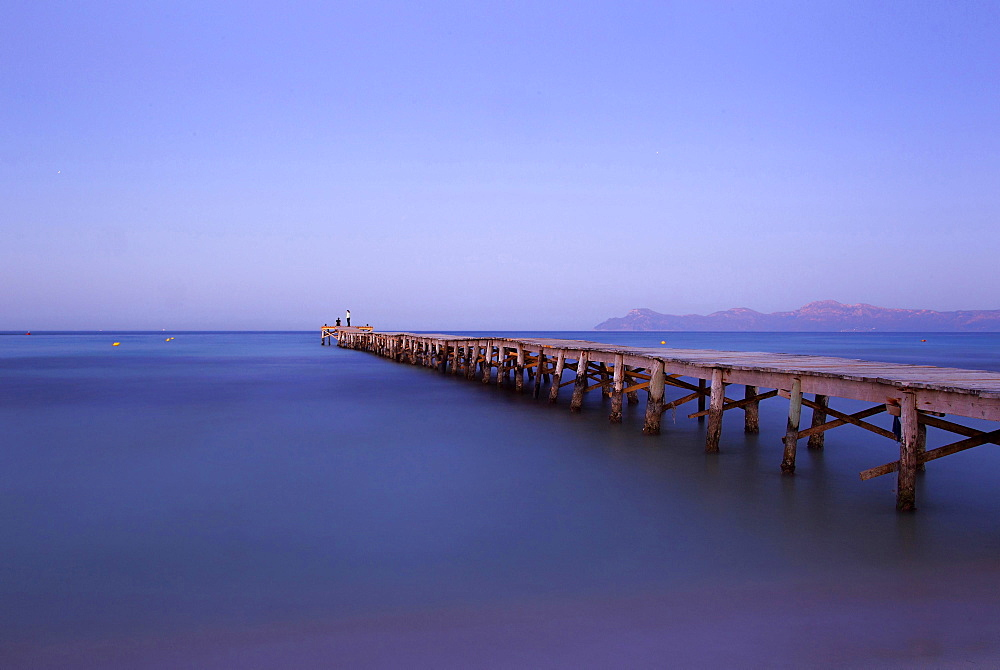 Jetty leading out into the sea, Alcudia, Majorca, Balearic Islands, Spain, Europe