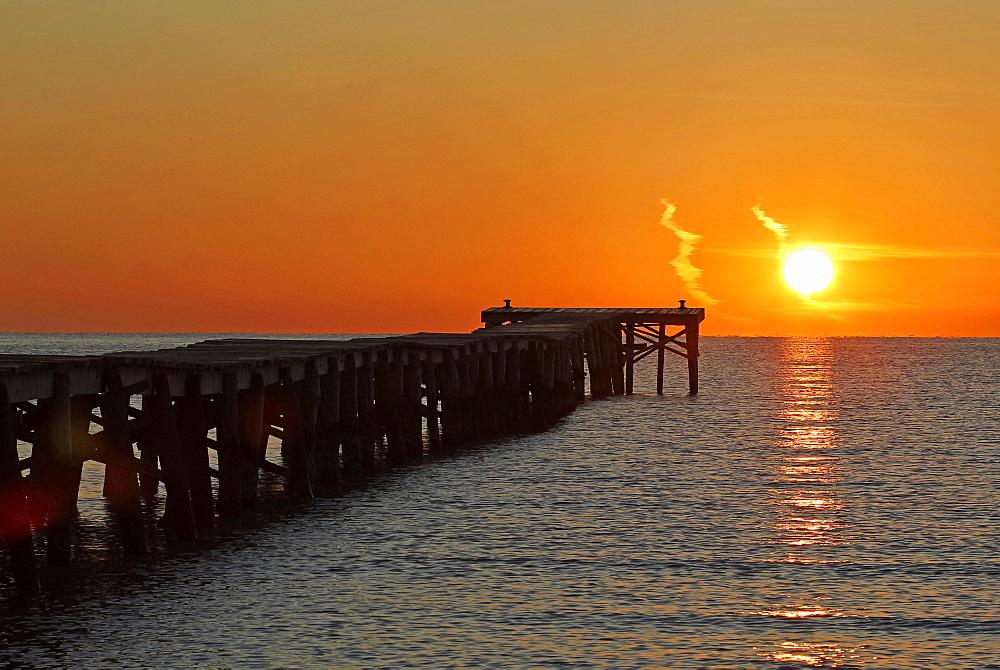 Sunrise at a jetty leading out into the sea, Alcudia, Majorca, Balearic Islands, Spain, Europe