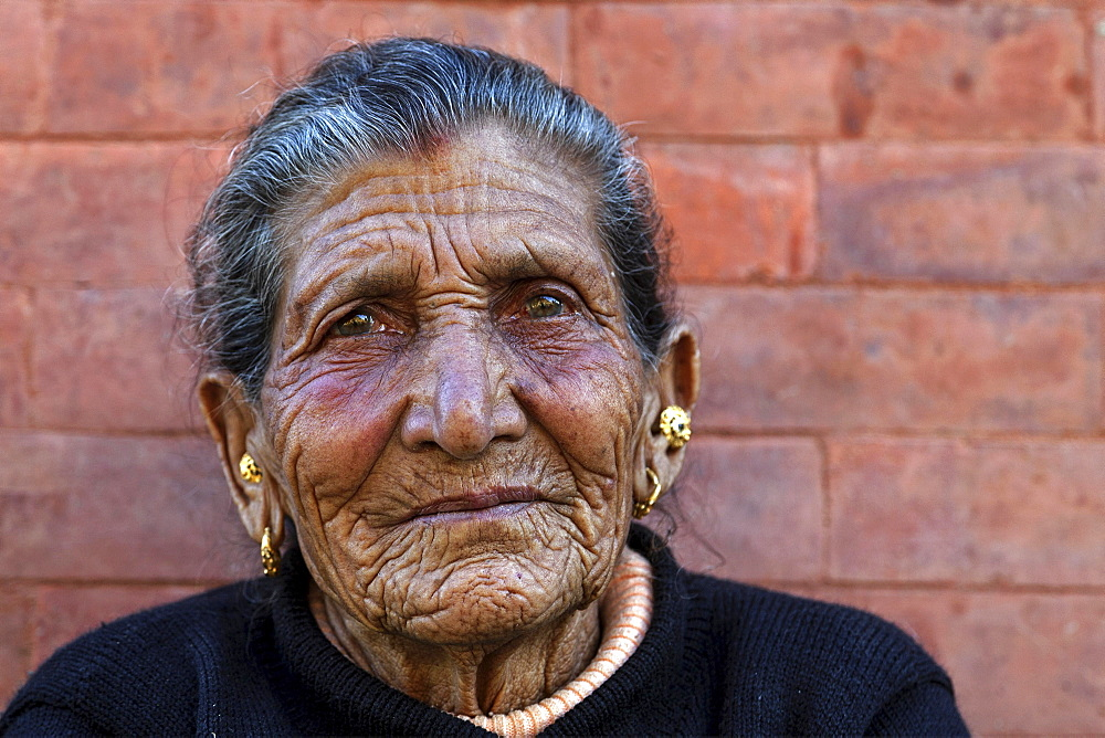 Old Nepalese woman, furrows in her face, ear jewellery, portrait, near Panauti, Nepal, Asia