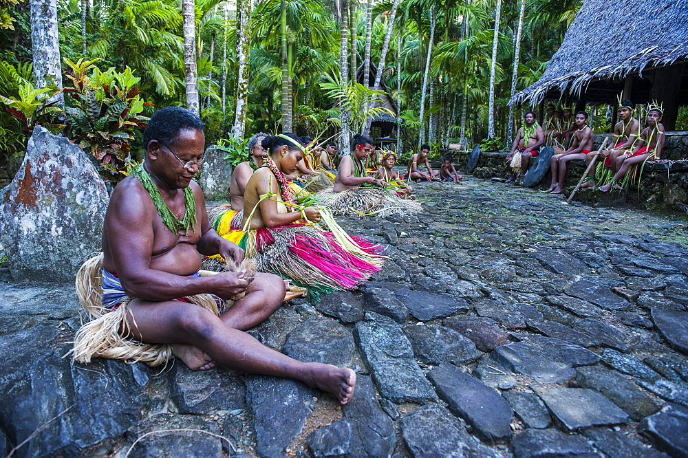 Traditionally dressed islanders making traditional art work, Yap Island, Caroline Islands, Micronesia, Oceania