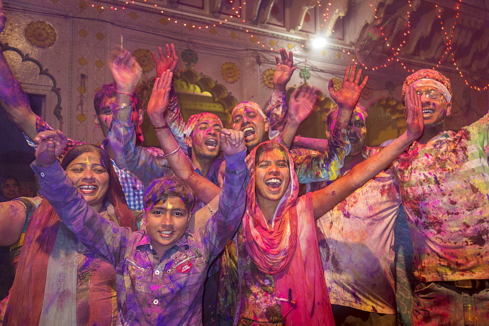 Devotees covered in coloured powder celebrating, Holi festival, Banke Bihari Temple, Vrindavan, Uttar Pradesh, India, Asia