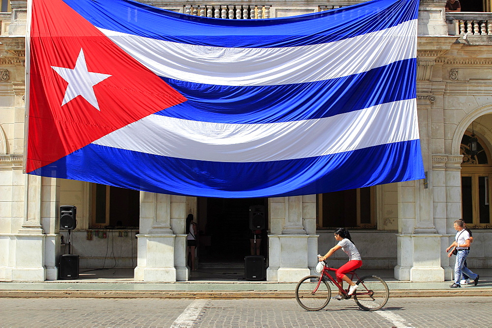 Large Cuban flag, hangs from building, Santa Clara, Cuba, Central America