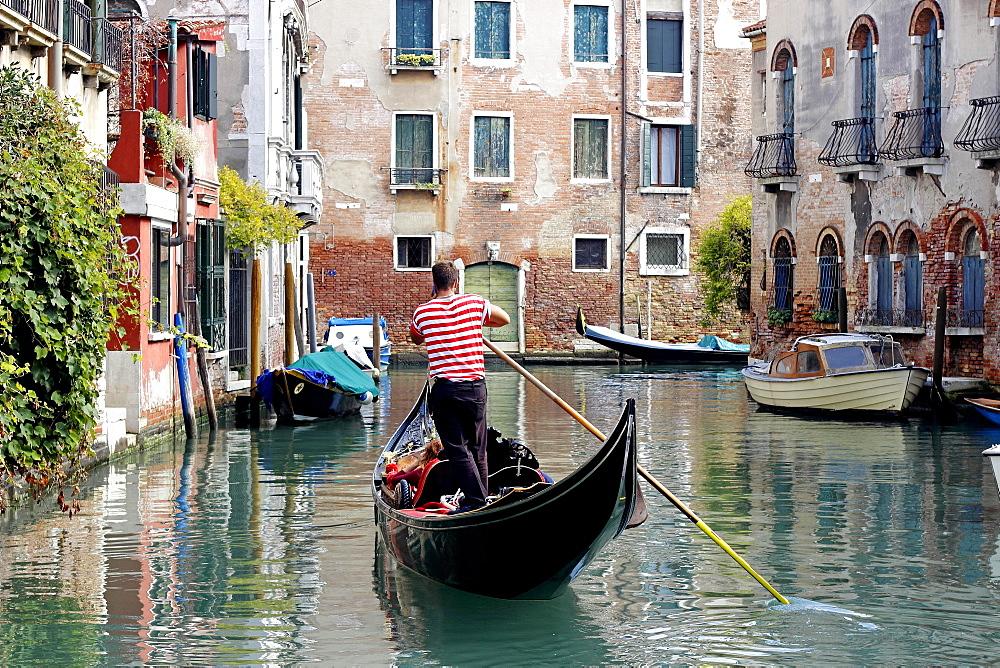 Gondola with gondolier using cell phone, Dorsoduro, Venice, Veneto, Italy, Europe