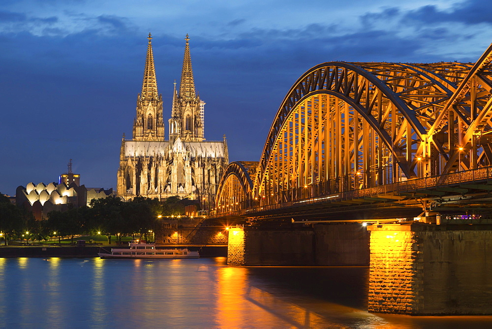 Cologne Cathedral with Hohenzollern Bridge and Cologne Philharmonic Hall at dusk, the Rhine at the front, Cologne, North Rhine-Westphalia, Germany, Europe