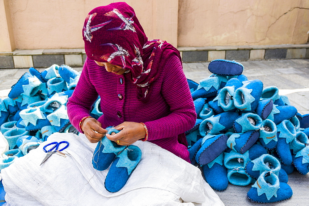 Woman working on felt shoes, Kathmandu, Kathmandu, Nepal, Asia