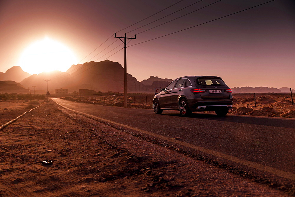 Mercedes Benz GLC250 SUV on the road, Sonenuntergang in Petra, Jordan, Asia
