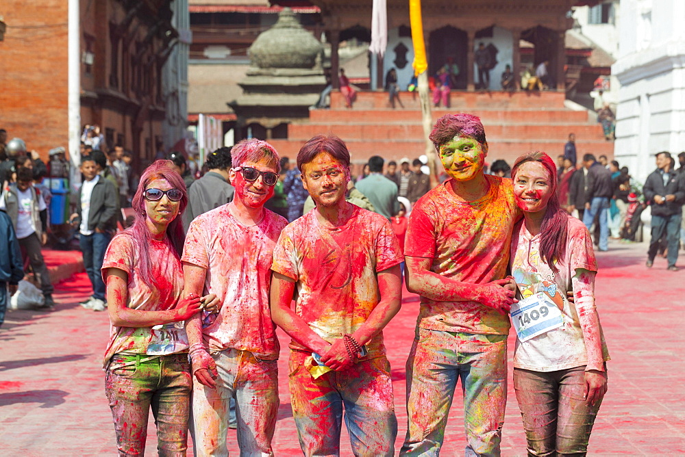 Participants of the colour run, part of the Holi festival celebrations, Kathmandu, Nepal, Asia