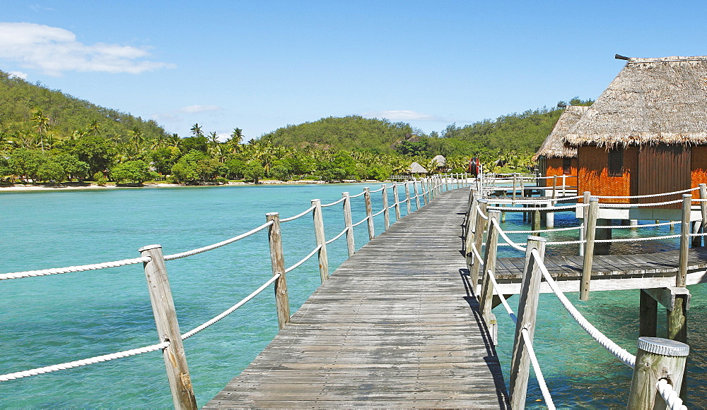 Wooden walkway to overwater bungalows in the sea, the South Seas, Malolo Island, Mamanuca Islands, Fiji, Oceania