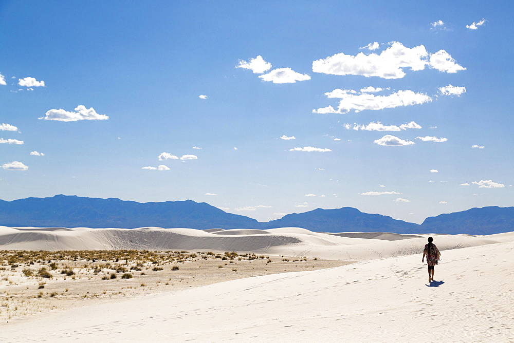Sand dunes, person in the backlight, mountains behind, White Sands National Monument, Alamogordo, New Mexico, USA, North America