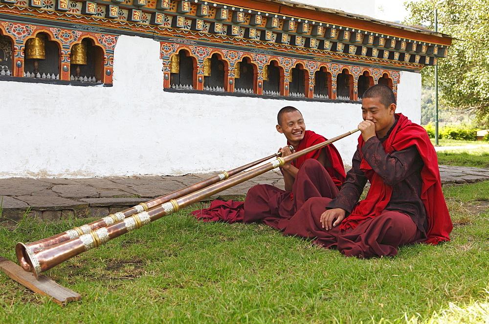 Monks playing tibetan horns, Chimi Temple, Punakha District, Bhutan, Asia