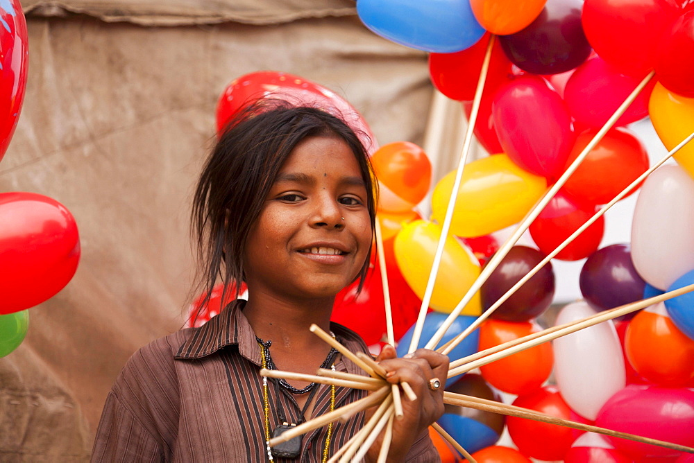Portrait of a young girl with colorful balloons, Pushkar, Rajasthan, India, Asia